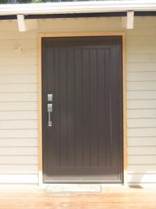 Tounge _ Grove aluminium panel door. Colour - Ironsand